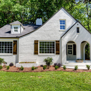 Inspiration for a transitional white one-story stone gable roof remodel in Atlanta with a shingle roof