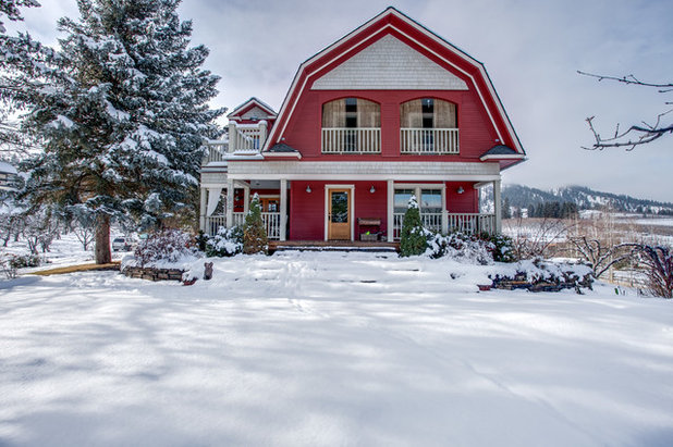 Farmhouse Exterior by Travis Knoop Photography