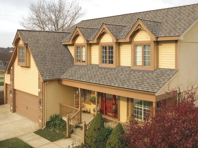 Traditional Exterior by Peak Roofing Contractors