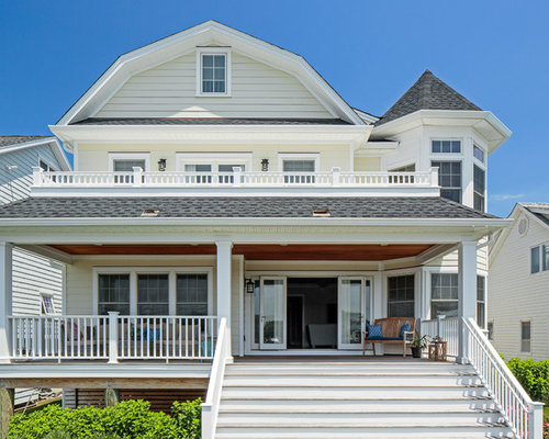 Coastal Beige Two Story Exterior Home Photo In New York With A Gambrel Roof  And