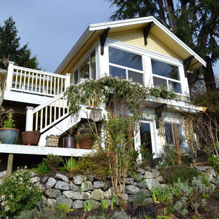 Example of a classic yellow exterior home design in Seattle