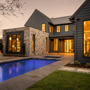 Example of a country exterior home design in Dallas