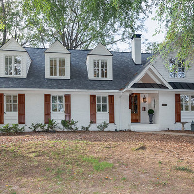 Mid-sized transitional white two-story brick exterior home idea in Raleigh with a shingle roof