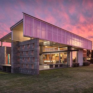 Idee per la facciata di una casa unifamiliare grande grigia contemporanea a un piano con rivestimento in mattoni