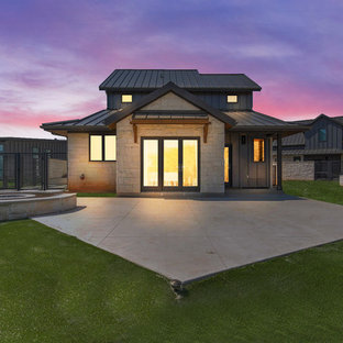 Inspiration for a mid-sized craftsman white two-story stone exterior home remodel in Dallas with a metal roof