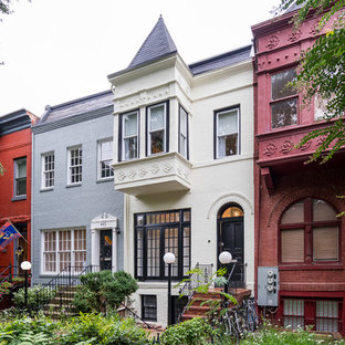 Inspiration for a mid-sized timeless beige three-story brick exterior home remodel in DC Metro with a tile roof