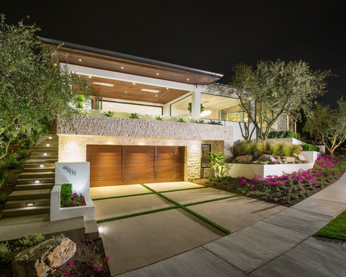 Large Trendy White Two Story Stucco Flat Roof Photo In Orange County