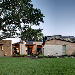 Inspiration for a contemporary exterior in Dallas with mixed siding.
