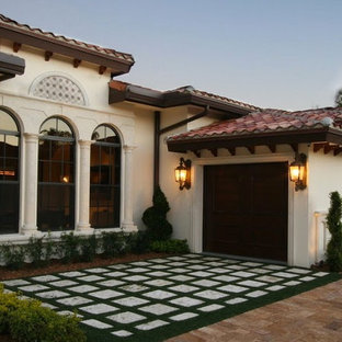 Example of a small tuscan white one-story stucco exterior home design in Miami