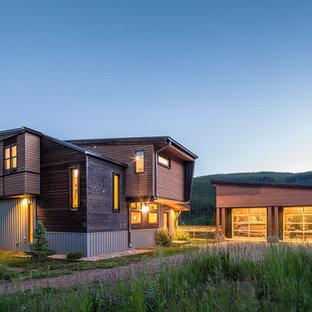 Rustic brown two-story wood exterior home idea in Denver with a shed roof