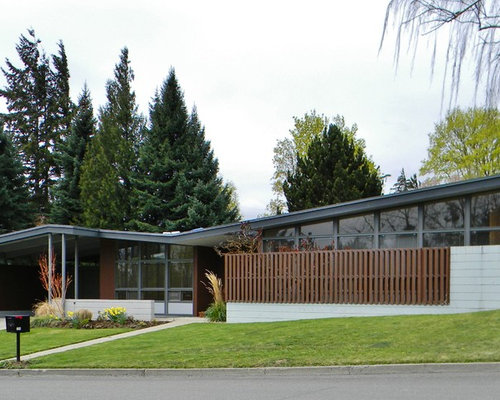 midcentury modern concrete exterior home photo in seattle