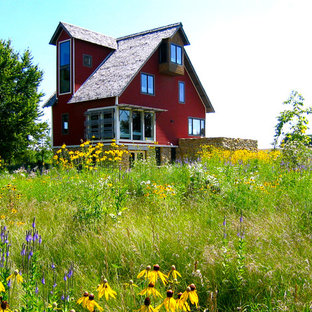 Inspiration for a farmhouse red three-story exterior home remodel in Minneapolis