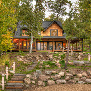Inspiration for a mid-sized rustic brown two-story wood exterior home remodel in Minneapolis with a shingle roof