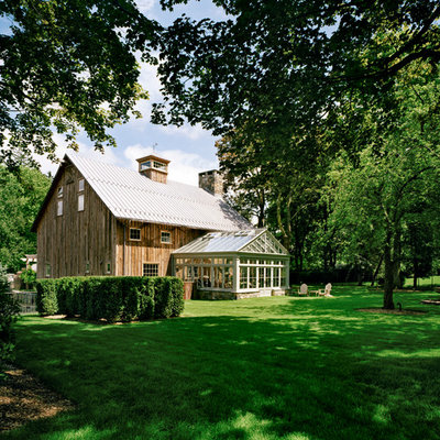 Large country brown two-story wood gable roof photo in New York