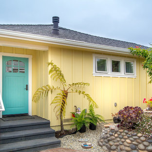 Small beach style yellow one-story wood gable roof idea in San Francisco