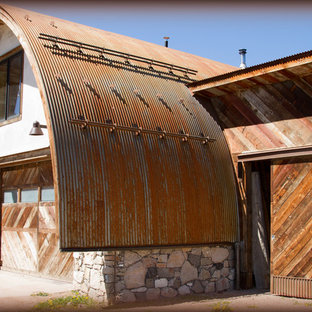 Mountain style white mixed siding exterior home photo in Denver with a metal roof