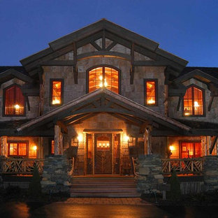 Design ideas for an expansive country two-storey brown exterior in Charlotte with mixed siding.