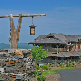 Example of a huge mountain style brown two-story mixed siding exterior home design in Charlotte