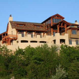 Inspiration for a huge rustic three-story stone exterior home remodel in Other