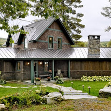 rustic exterior by Smith & Vansant Architects PC