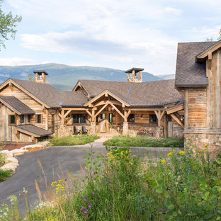 Example of a large mountain style brown three-story wood gable roof design in Denver with a shingle roof