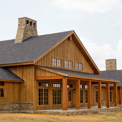 Example of a farmhouse wood exterior home design in New Orleans