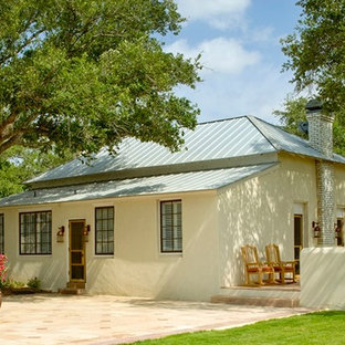 Inspiration for a southwestern black adobe exterior home remodel in Houston