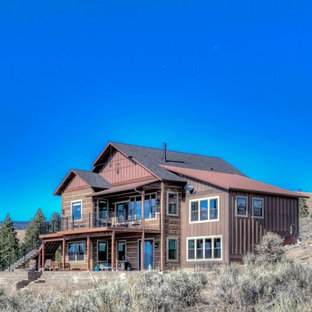 Inspiration for a large craftsman brown two-story wood exterior home remodel in Other with a shingle roof