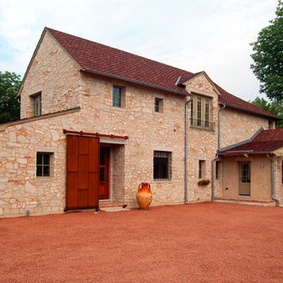 French country stone exterior home photo in Chicago