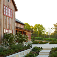 Rustic Exterior by Addison Landscape & Maintenance, Inc.