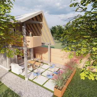 На фото: маленький, двухэтажный, серый мини-дом в стиле модернизм с комбинированной облицовкой, двускатной крышей и металлической крышей