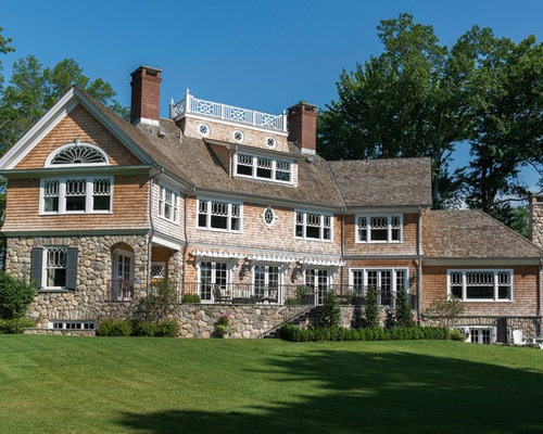 huge beach style beige three story wood exterior home idea in new york with a - Home Exterior