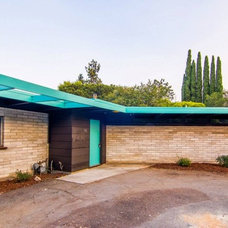 Midcentury Exterior by Modern Homes Realty
