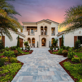 Inspiration for a huge mediterranean white three-story exterior home remodel in Tampa