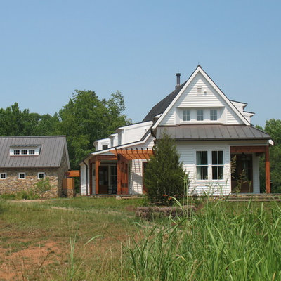 Example of a mid-sized farmhouse white two-story wood exterior home design in Richmond