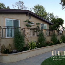 Traditional Exterior by Element Construction Masonry & Paving