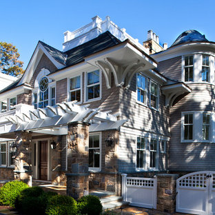 Design ideas for a victorian exterior in Other with wood siding.