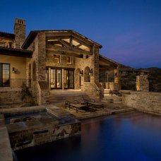 Traditional Exterior by Calvis Wyant Luxury Homes