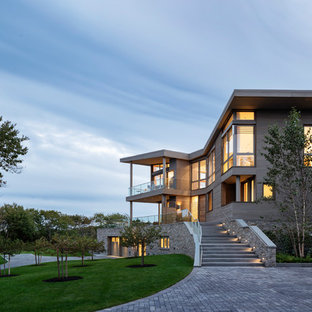 Inspiration for a large contemporary gray three-story wood exterior home remodel in Providence