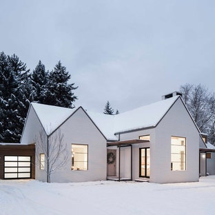 Large modern white two-story exterior home idea in Salt Lake City with a clipped gable roof