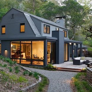 Design ideas for a large modern two-storey grey exterior in San Francisco with vinyl siding and a gambrel roof.