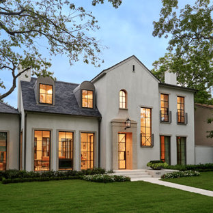 Inspiration for a large mediterranean beige two-story stucco exterior home remodel in Dallas with a shingle roof