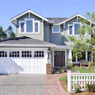 This is an example of an arts and crafts exterior in San Francisco with wood siding.