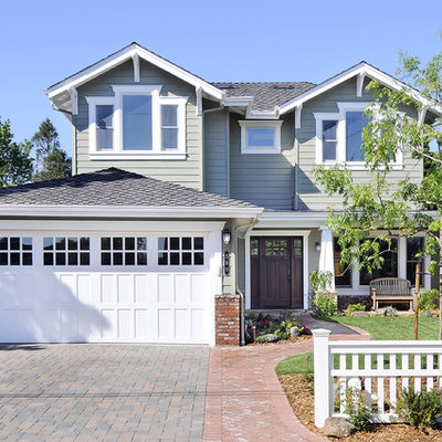Example of an arts and crafts wood exterior home design in San Francisco