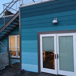 サンフランシスコのエクレクティックスタイルのおしゃれな家の外観 (漆喰サイディング、紫の外壁、タウンハウス) の写真