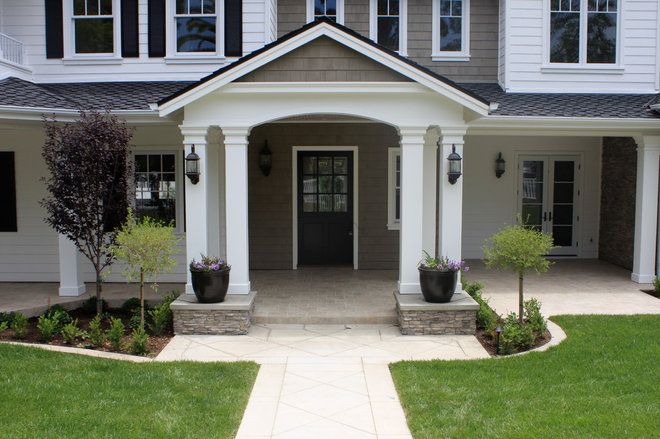 Traditional Exterior by Devon Design, Inc.