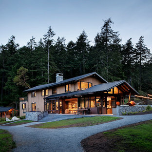 Inspiration for a large rustic three-story exterior home remodel in Seattle