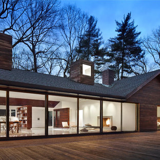 Example of a danish one-story wood gable roof design in New York