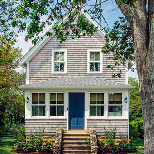 Beach style beige two-story wood exterior home idea in Boston with a shingle roof