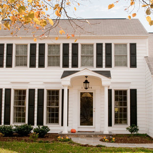 Inspiration for a mid-sized timeless white two-story vinyl exterior home remodel in DC Metro with a shingle roof